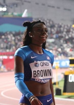 Brittany Brown catches her breath and glances at the billboard moments after her silver medal performance in the Women's 200 m Finals at IAAF World Championships of 22.22 seconds.