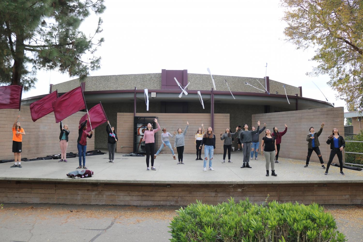 Students in the color guard practice on the band stage during the school period allocated to them for training. At other schools, sports teams get periods to train during the school day.