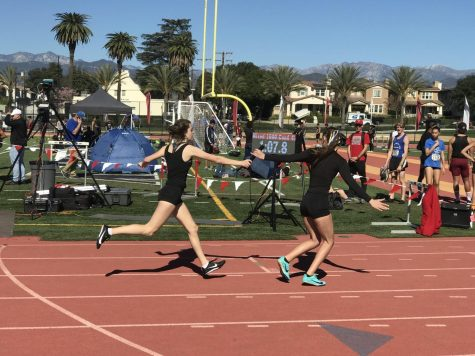 Californian athletes hand off the baton in the Mixed 4x400-Meter Relay at a qualifying meet in Covina for the California Winter Track & Field Championships. New to high school winter and indoor track competitions, the event will also be run at the upcoming Olympic Games in Tokyo.