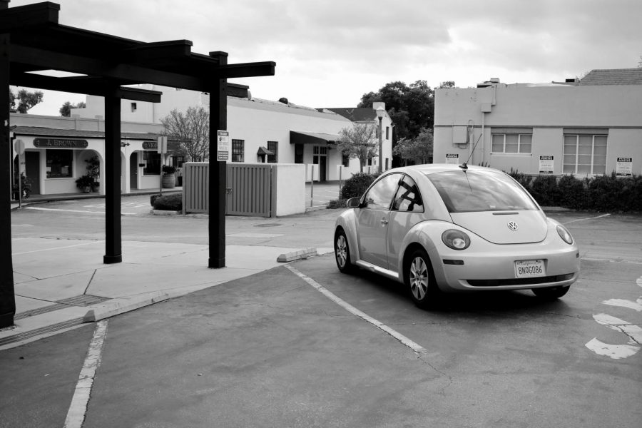 My car, Bug, sits alone in the parking lot of Rhino Records.