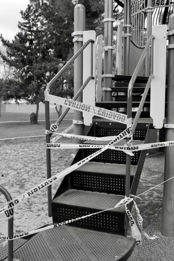 Littered with caution tape, city parks are closed for the foreseeable future, with children not permitted to play on the structures.
