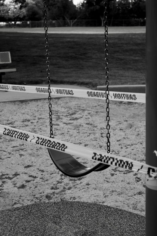 Swings at the park also taped up to prevent usage.