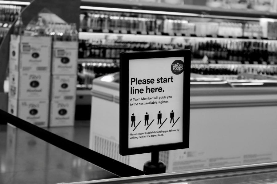Whole Foods stations patrons 6 ft apart in line in order to follow CDC social distancing guidelines