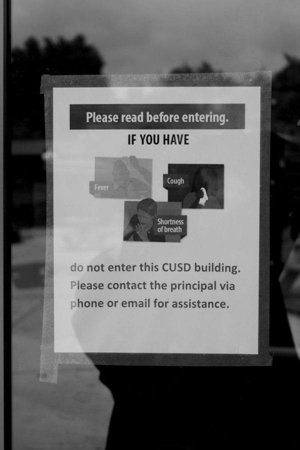 Warnings line the windows and doors of CHS buildings for those teachers who still have campus access