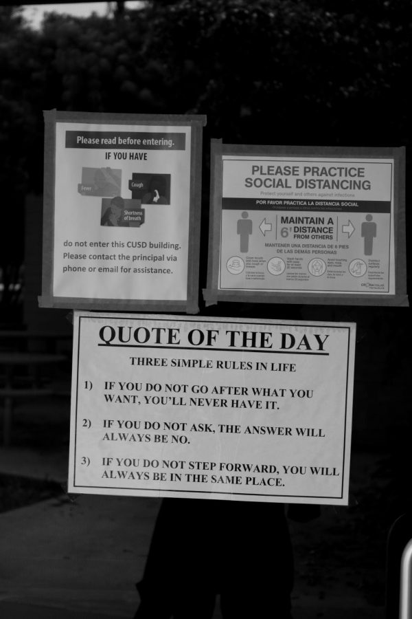Warning signs outside the CHS Library, complete without a seemingly out of date