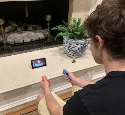 "Asst. Sports Editor Charlie Warren plays ""Animal Crossing: New Horizons"" on his Nintendo Switch."