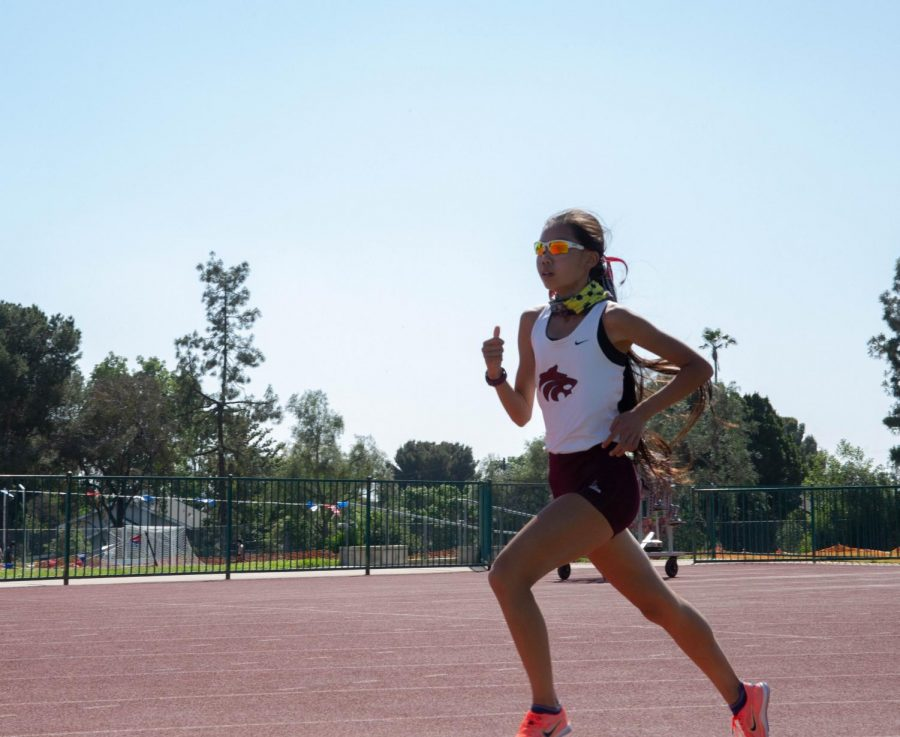 Denise+Chen+runs+a+1600-meter+race+against+Alta+Loma+on+May+4%2C+which+she+won%2C+gliding+past+her+competition.
